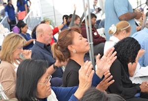 sitting_praying_hands_up